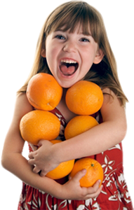 LITTLE GIRL HOLDING ORANGES